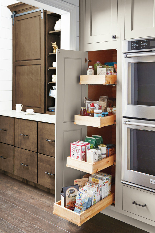 Kitchen pantry - transitional medium tone wood floor and brown floor kitchen pantry idea in Other with white cabinets, stainless steel appliances and an island
