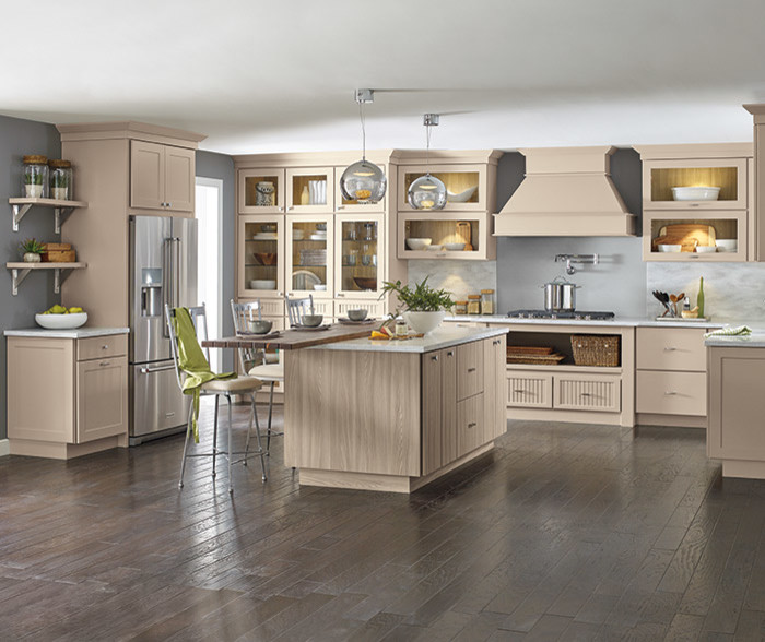 Large transitional u-shaped dark wood floor and brown floor eat-in kitchen photo with shaker cabinets, beige cabinets, stainless steel appliances, an island and white countertops