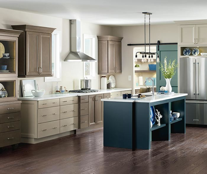 Example of a transitional l-shaped dark wood floor and brown floor eat-in kitchen design with beige cabinets, stainless steel appliances and an island