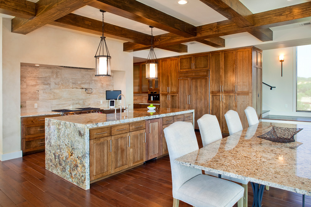 Inspiration for a mediterranean kitchen remodel in Austin with granite countertops