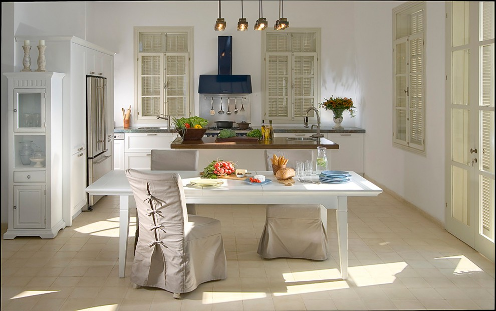 Cottage chic galley eat-in kitchen photo in Other with white cabinets, stainless steel appliances and recessed-panel cabinets