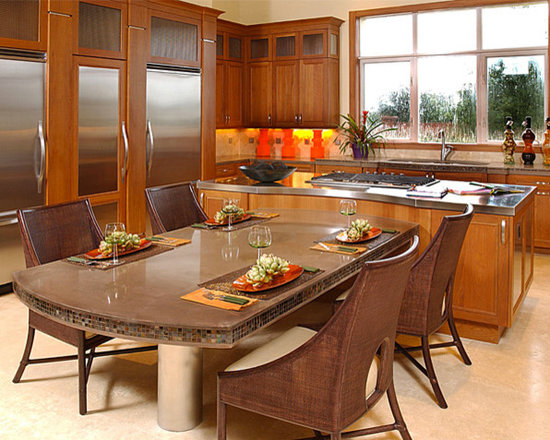 Dining Table - This is a custom kitchen table with matching kitchen surround. This counter is two inches thick and has a custom edge profile, pricing out at $80 per square foot.