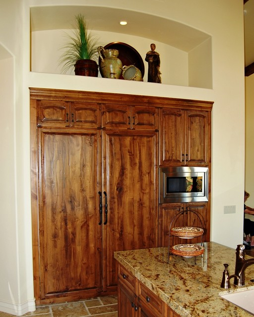 Mediterranean Kitchen Cabinets: Distressed Refer Doors On Dual Sub-Zero Refrigertors