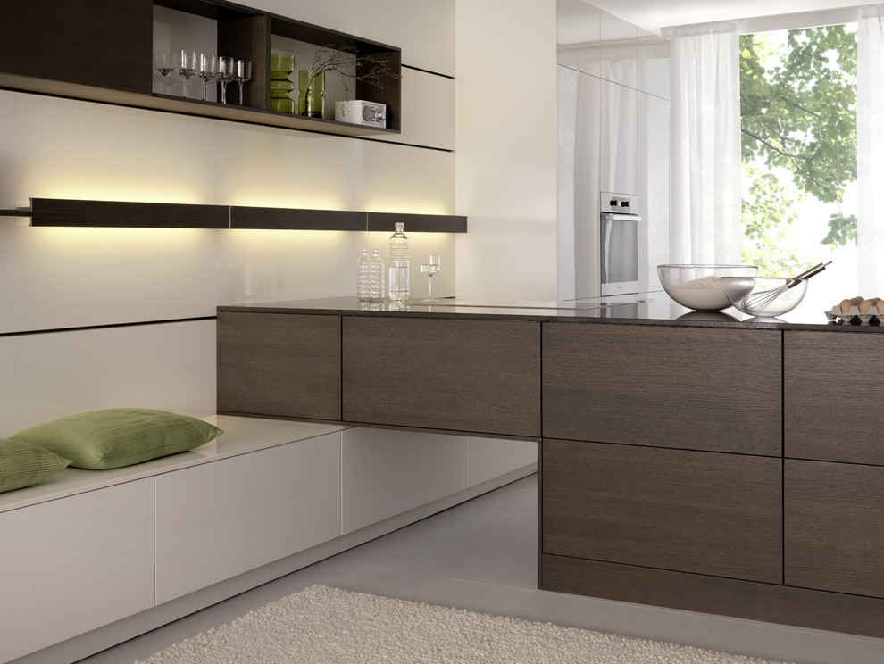 Inspiration for a modern open concept kitchen remodel in Boston with flat-panel cabinets, white cabinets and stainless steel appliances