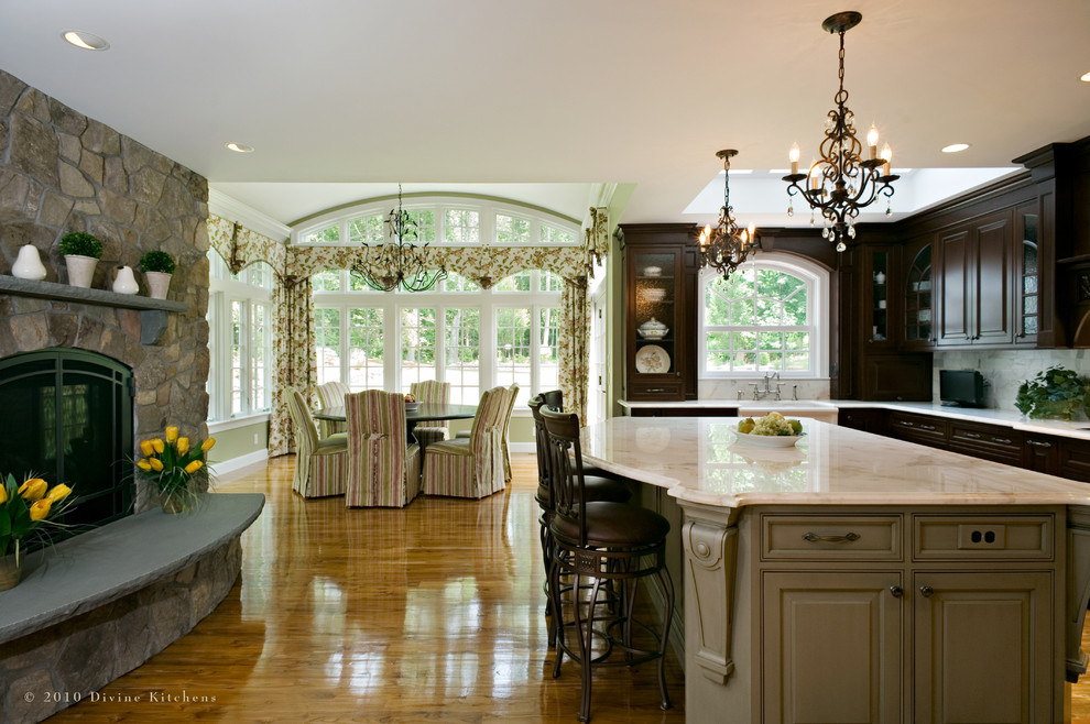 Large elegant l-shaped dark wood floor eat-in kitchen photo in Boston with a farmhouse sink, beaded inset cabinets, dark wood cabinets, marble countertops, stainless steel appliances and an island
