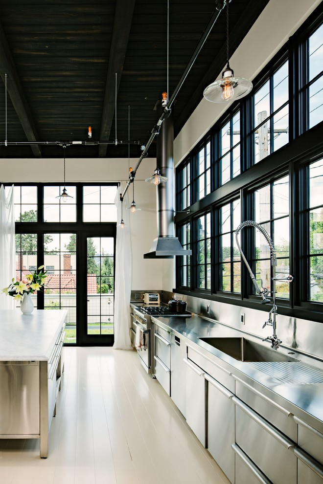 Kitchen - industrial single-wall kitchen idea in Portland with an integrated sink, stainless steel cabinets, stainless steel countertops, metallic backsplash, metal backsplash and stainless steel appliances