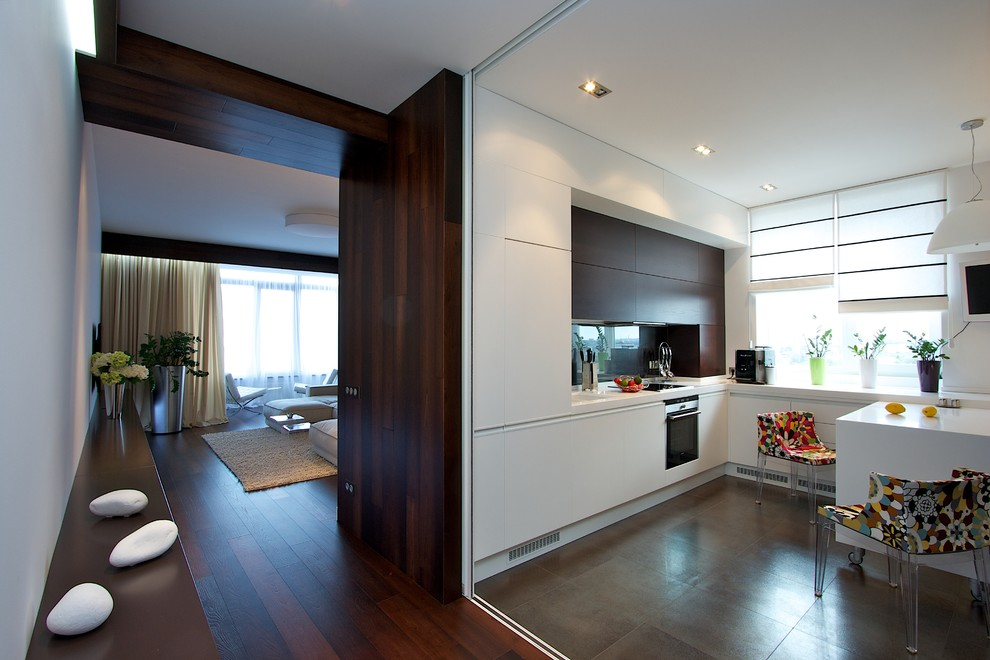 Inspiration for a contemporary kitchen remodel with flat-panel cabinets, white cabinets and stainless steel appliances