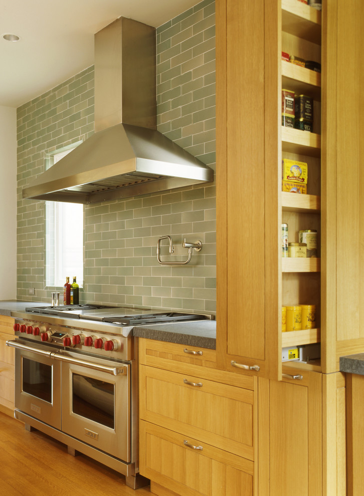 Ornate kitchen photo in San Francisco with light wood cabinets and gray backsplash