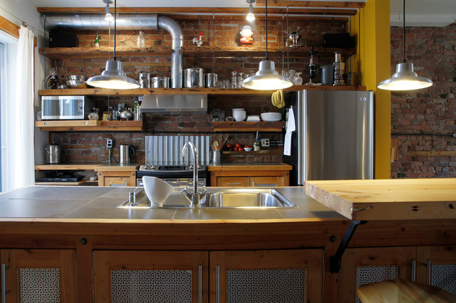 Industrial Galley Kitchen Idea In Montreal With A Drop In Sink,  Recessed Panel