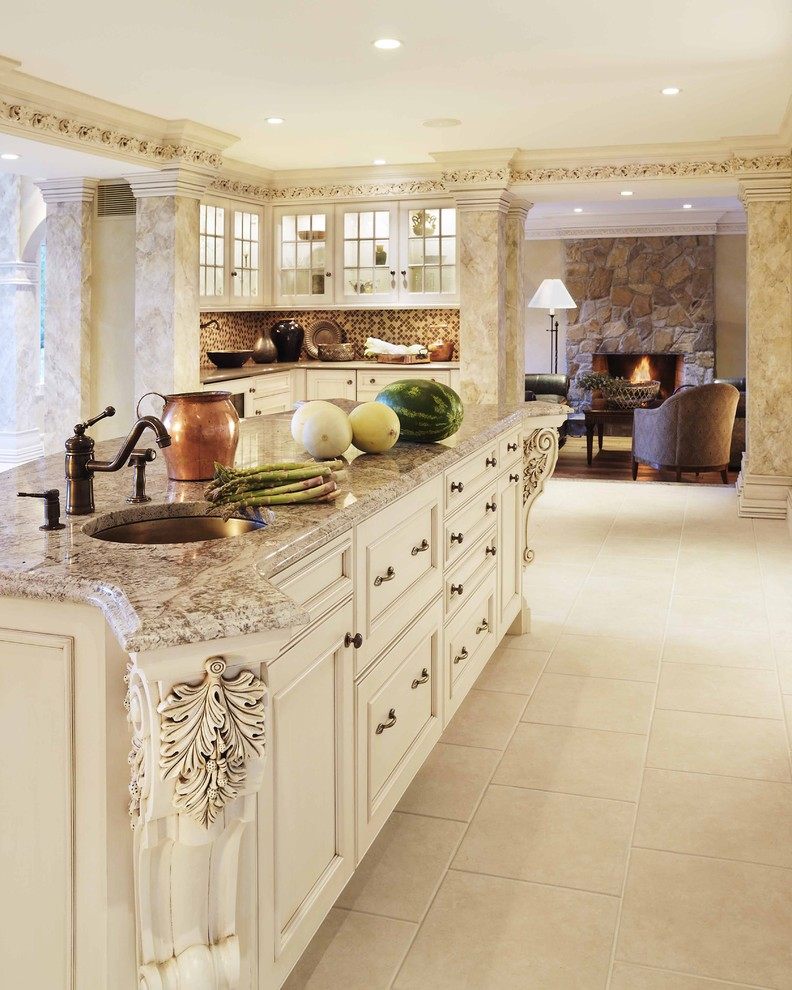 Example of a classic kitchen design in Boston with recessed-panel cabinets, an undermount sink, beige cabinets, granite countertops, brown backsplash and mosaic tile backsplash