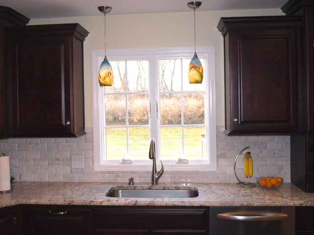 Double pendant lights over sink traditional kitchen for Over the kitchen sink pendant lights