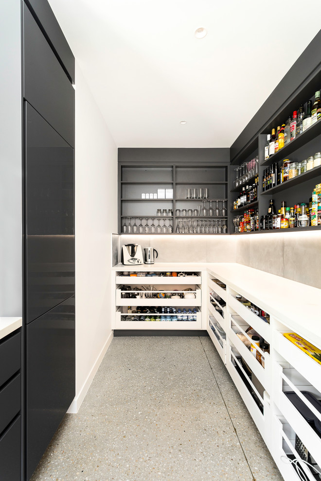 Inspiration for a contemporary l-shaped gray floor kitchen pantry remodel in Brisbane with open cabinets, black cabinets, cement tile backsplash, no island and white countertops