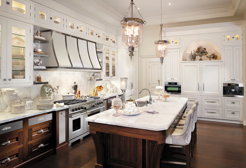 Example of a classic galley kitchen design in New York with recessed-panel cabinets, white cabinets and white backsplash