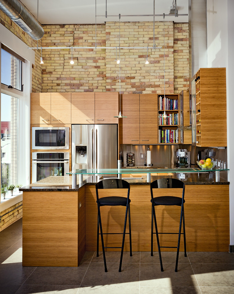 Inspiration for an industrial kitchen remodel in Other with flat-panel cabinets, medium tone wood cabinets, metallic backsplash, stainless steel appliances and a peninsula