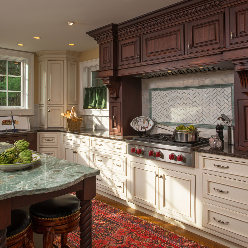 Inspiration for a large timeless u-shaped medium tone wood floor enclosed kitchen remodel in Boston with dark wood cabinets, white backsplash, subway tile backsplash, an island, an undermount sink, beaded inset cabinets, paneled appliances and granite countertops