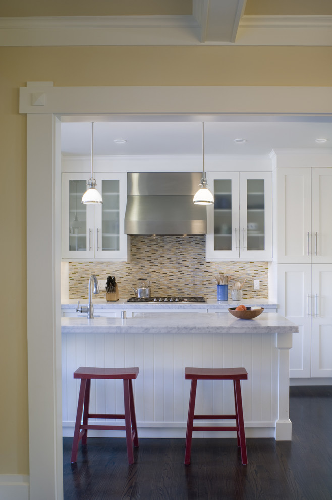 Inspiration for a contemporary kitchen remodel in San Francisco with glass-front cabinets, marble countertops, white cabinets, multicolored backsplash and matchstick tile backsplash