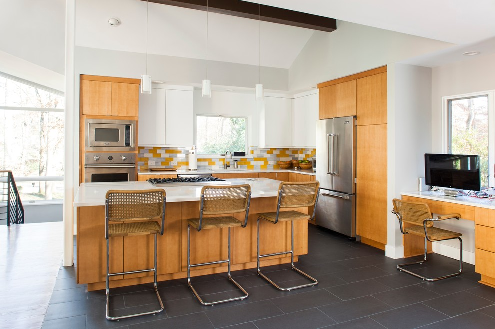 Eat-in kitchen - mid-century modern l-shaped eat-in kitchen idea in Atlanta with quartzite countertops, yellow backsplash, glass tile backsplash, stainless steel appliances, a single-bowl sink, flat-panel cabinets and light wood cabinets