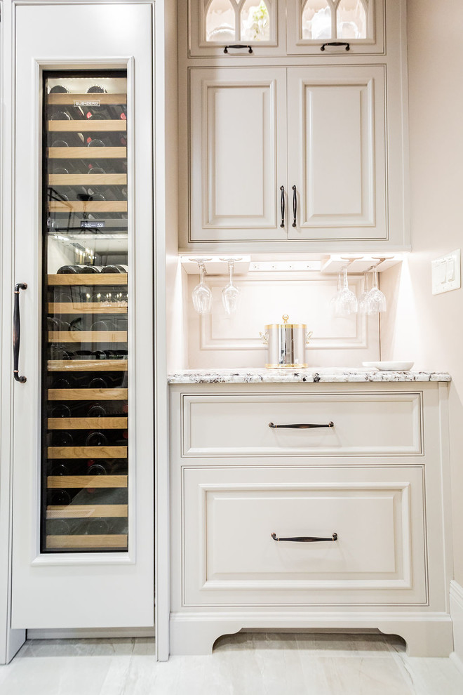 Inspiration for a large transitional porcelain floor and beige floor kitchen remodel in Other with a farmhouse sink, beaded inset cabinets, gray cabinets, granite countertops, porcelain backsplash, stainless steel appliances, an island and beige countertops