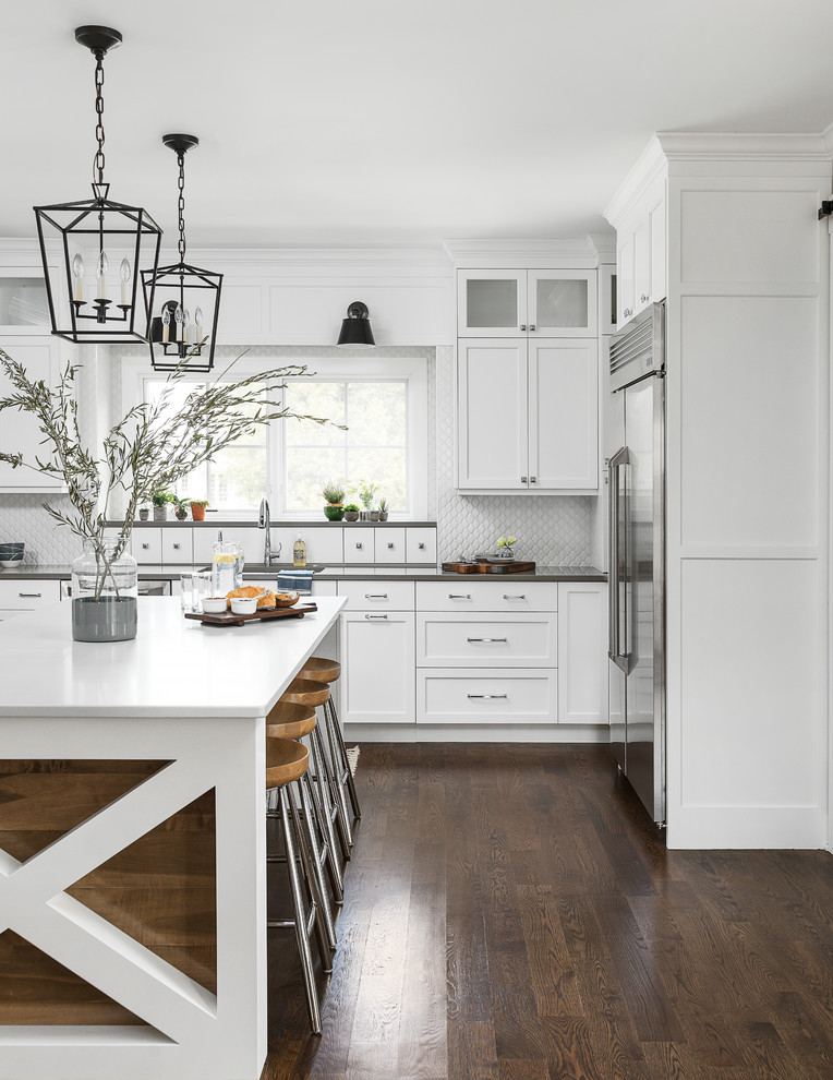 Inspiration for a large coastal medium tone wood floor and brown floor eat-in kitchen remodel in Chicago with an undermount sink, beaded inset cabinets, white cabinets, quartz countertops, white backsplash, ceramic backsplash, stainless steel appliances, an island and white countertops