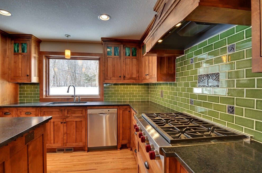 Example of an arts and crafts kitchen design in Minneapolis with stainless steel appliances