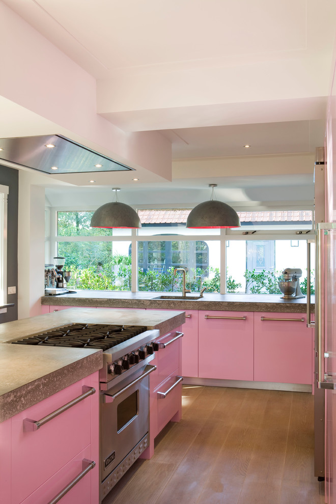 Inspiration for a modern kitchen remodel in New York with concrete countertops and stainless steel appliances