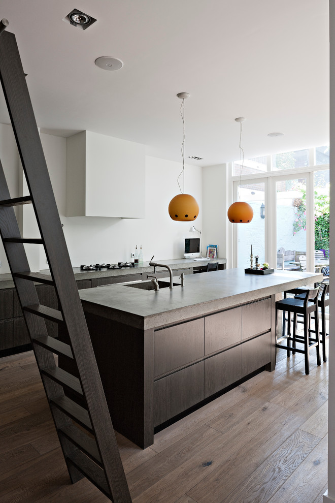 Inspiration for a modern kitchen remodel in New York with concrete countertops