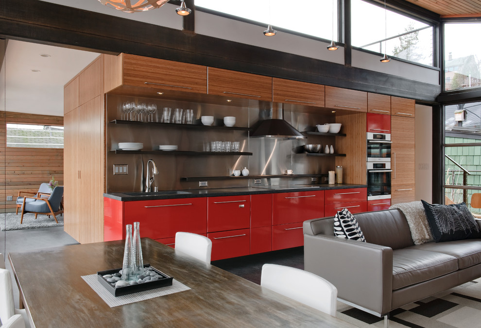 Urban single-wall open concept kitchen photo in Seattle with open cabinets, red cabinets, metallic backsplash, metal backsplash and paneled appliances