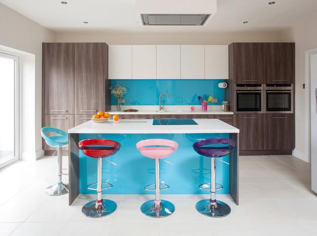 Example of a trendy galley ceramic floor kitchen design in Other with flat-panel cabinets, dark wood cabinets, blue backsplash, glass sheet backsplash and an island