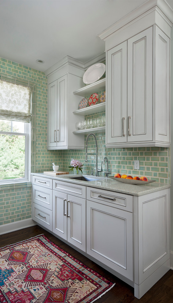 Enclosed kitchen - traditional galley dark wood floor enclosed kitchen idea in Detroit with recessed-panel cabinets, gray cabinets, green backsplash, a single-bowl sink, granite countertops, porcelain backsplash and stainless steel appliances