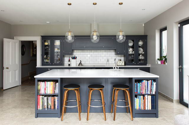 Design ideas for a classic open plan kitchen in London with a built-in sink, shaker cabinets, white splashback, an island, metro tiled splashback and grey cabinets.