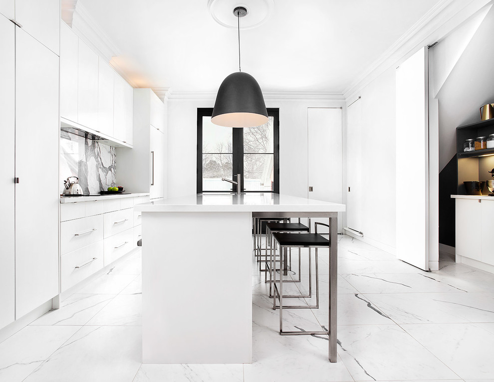 Kitchen pantry - large contemporary single-wall porcelain tile kitchen pantry idea in Toronto with an undermount sink, flat-panel cabinets, white cabinets, quartz countertops, white backsplash, stone slab backsplash, stainless steel appliances and an island