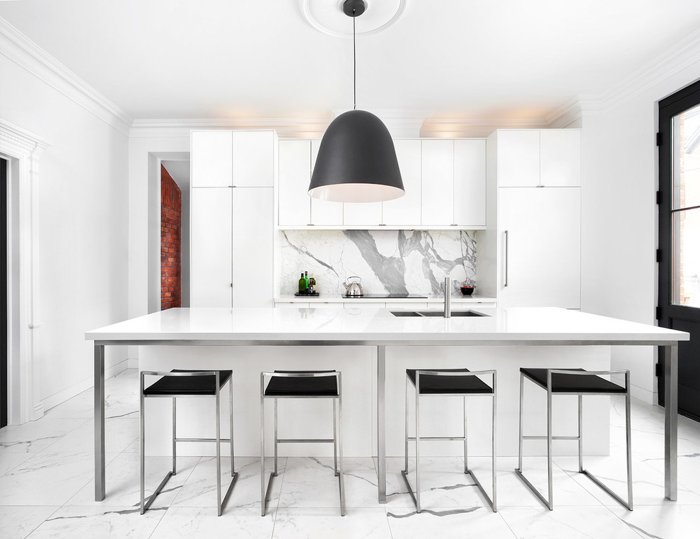 Inspiration for a large contemporary galley marble floor kitchen remodel in Toronto with an undermount sink, flat-panel cabinets, white cabinets, quartz countertops, white backsplash, stainless steel appliances, an island and marble backsplash