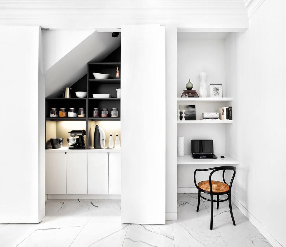 Large contemporary single-wall kitchen pantry in Toronto with flat-panel cabinets, white cabinets, engineered stone countertops, marble flooring, a submerged sink, white splashback, stone slab splashback, stainless steel appliances and an island.
