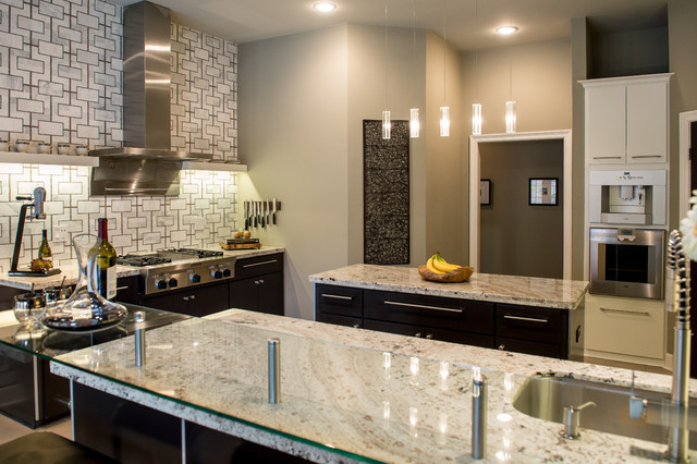 Eat-in kitchen - mid-sized contemporary u-shaped limestone floor eat-in kitchen idea in New Orleans with an integrated sink, flat-panel cabinets, white cabinets, granite countertops, multicolored backsplash, stainless steel appliances and an island