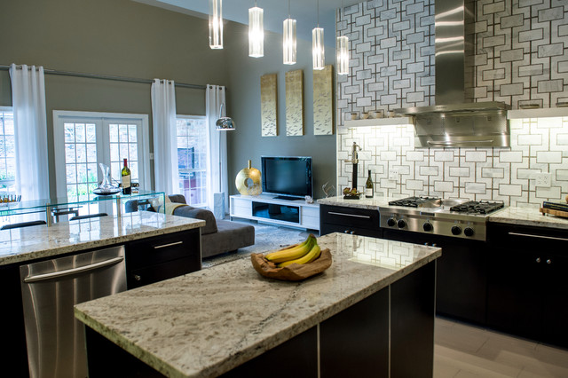 Eat-in kitchen - large contemporary u-shaped limestone floor eat-in kitchen idea in New Orleans with flat-panel cabinets, black cabinets, granite countertops, multicolored backsplash, stainless steel appliances and an island