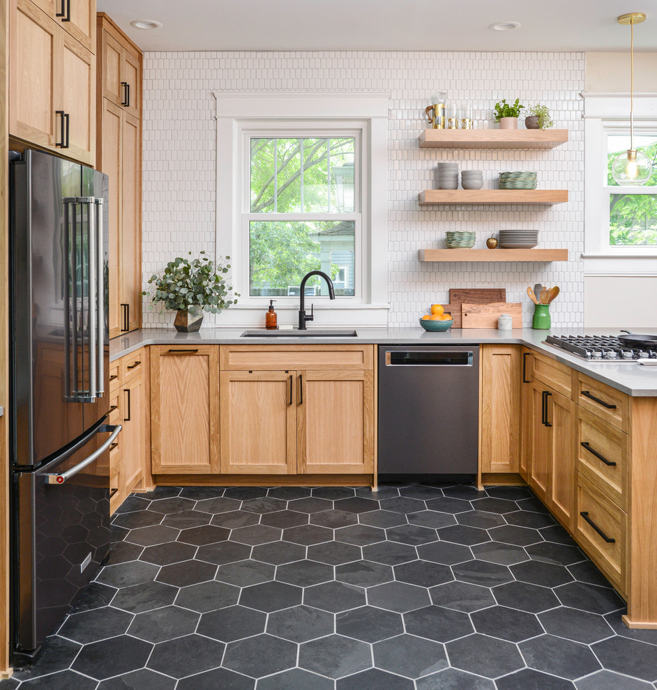 Transitional u-shaped gray floor eat-in kitchen photo in Nashville with an undermount sink, shaker cabinets, medium tone wood cabinets, white backsplash, black appliances, a peninsula and gray countertops