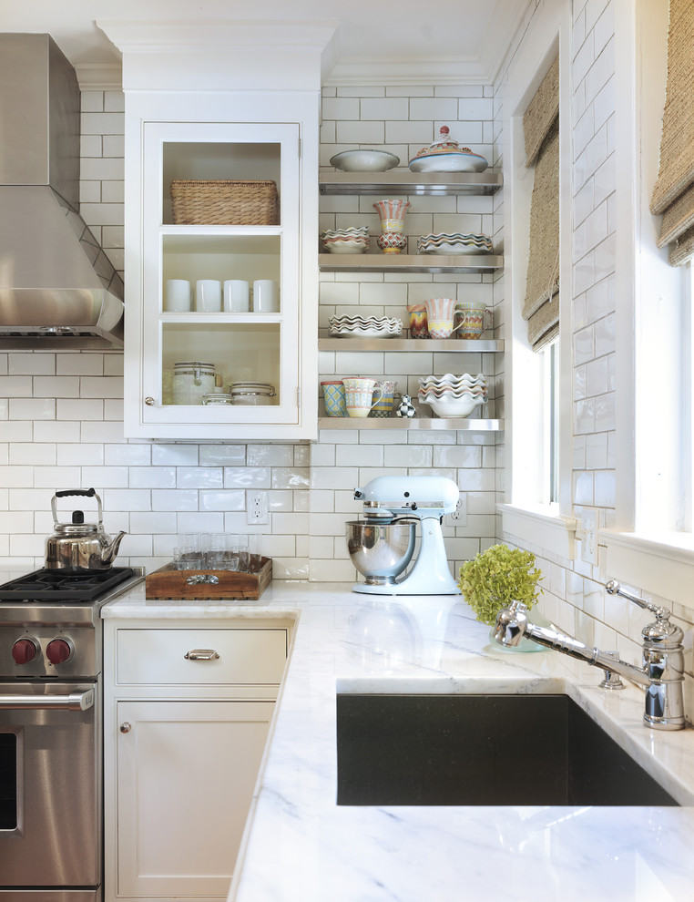 Inspiration for a timeless kitchen remodel in Providence with beaded inset cabinets, stainless steel appliances, a single-bowl sink, white cabinets, marble countertops, white backsplash and subway tile backsplash