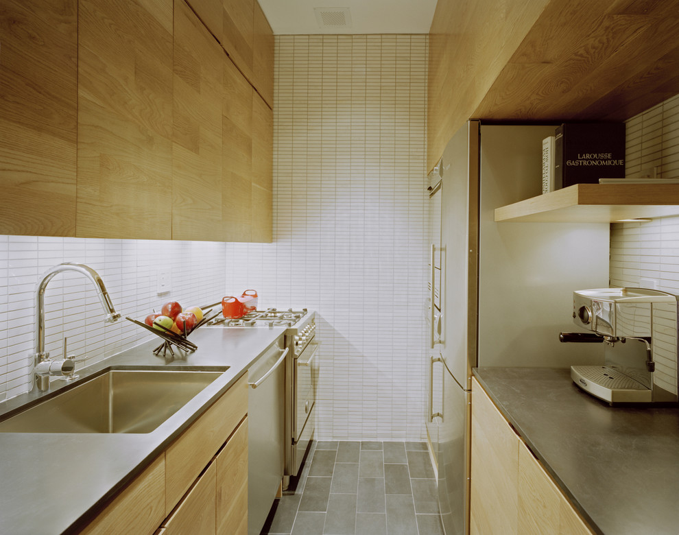 Enclosed kitchen - modern galley enclosed kitchen idea in New York with stainless steel appliances