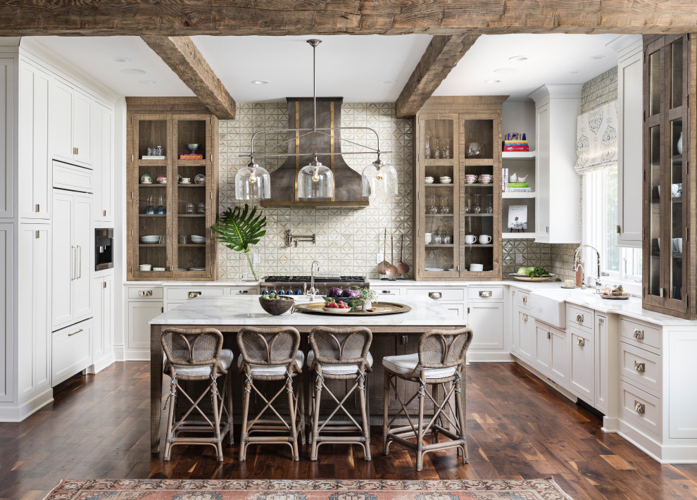 Transitional u-shaped dark wood floor and brown floor kitchen photo in Detroit with a farmhouse sink, shaker cabinets, white cabinets, beige backsplash, stainless steel appliances, an island and white countertops