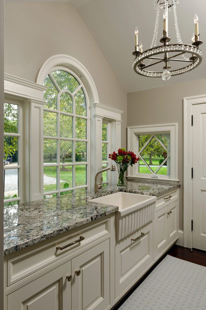 Example of a large classic dark wood floor eat-in kitchen design in Baltimore with a farmhouse sink, beaded inset cabinets, white cabinets, granite countertops, white backsplash, subway tile backsplash, stainless steel appliances and an island