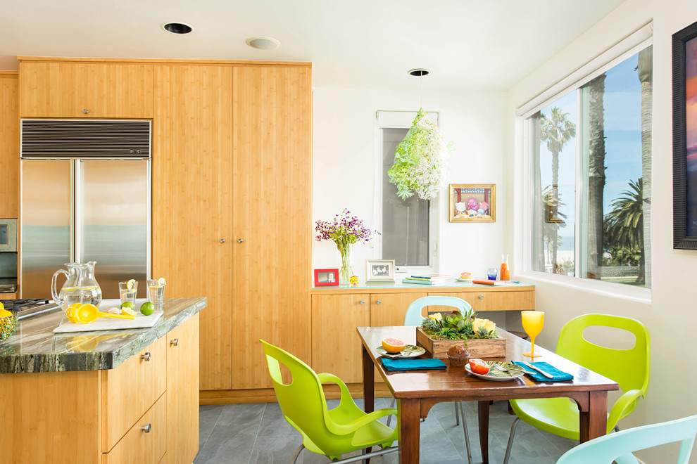 Eat-in kitchen - mid-sized coastal u-shaped porcelain tile and gray floor eat-in kitchen idea in Los Angeles with a double-bowl sink, flat-panel cabinets, light wood cabinets, granite countertops, blue backsplash, glass sheet backsplash, stainless steel appliances and an island