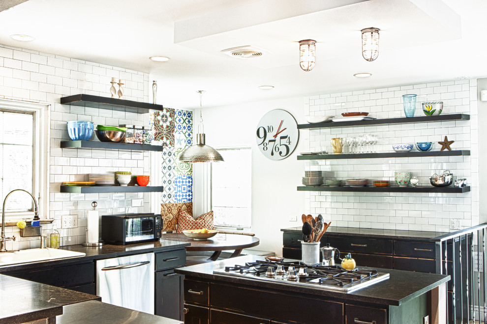 Inspiration for an eclectic kitchen remodel in Denver with subway tile backsplash, stainless steel appliances, open cabinets, distressed cabinets and white backsplash