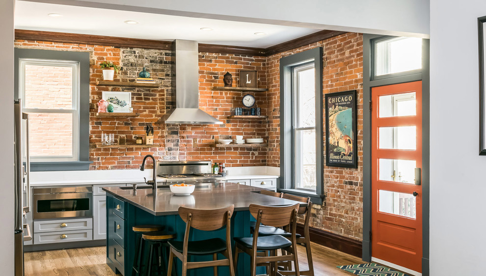 Eat-in kitchen - mid-sized eclectic l-shaped light wood floor and brown floor eat-in kitchen idea with a drop-in sink, recessed-panel cabinets, turquoise cabinets, quartz countertops, stainless steel appliances, an island and white countertops