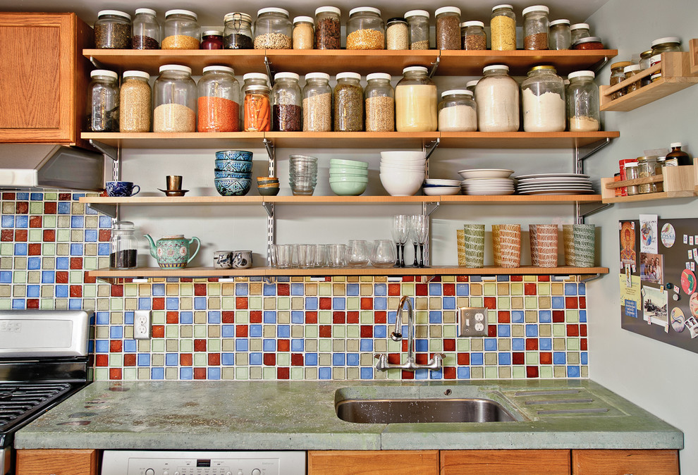 Kitchen - eclectic kitchen idea in Philadelphia with medium tone wood cabinets, concrete countertops and multicolored backsplash