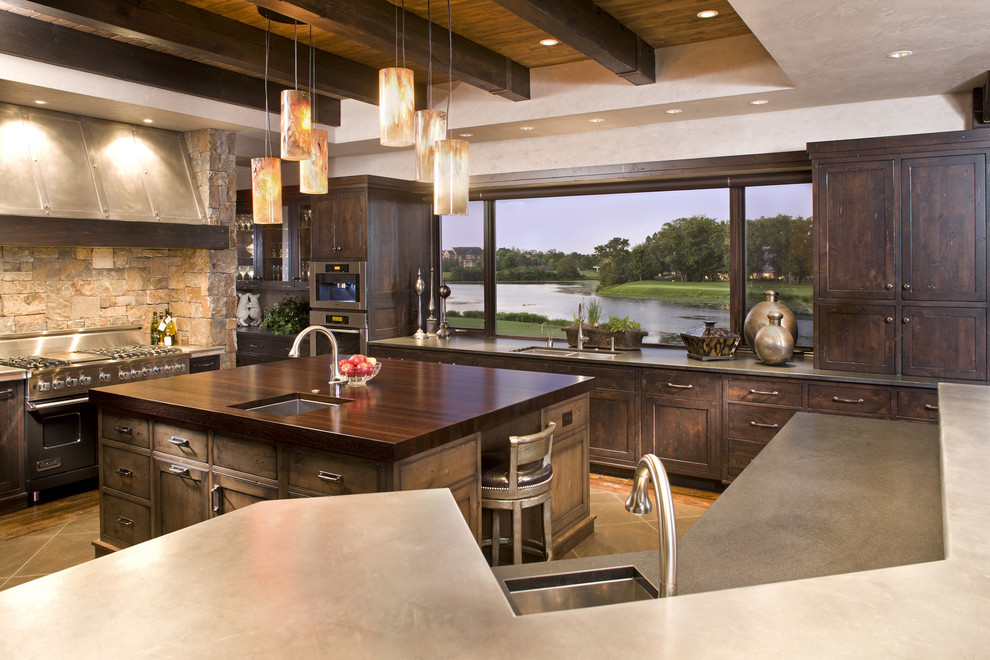 Example of a mountain style kitchen design in Minneapolis with stainless steel appliances