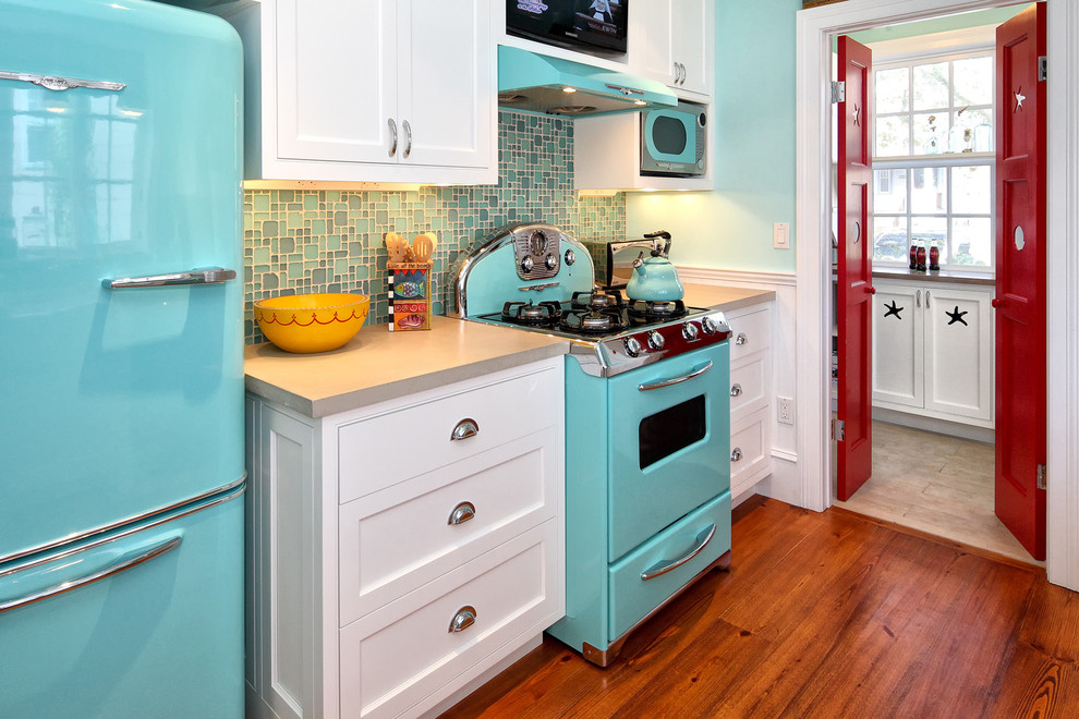 Inspiration for a midcentury modern kitchen remodel in Philadelphia with colored appliances, concrete countertops, shaker cabinets and white cabinets