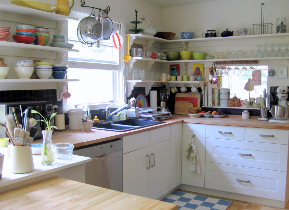 Eclectic kitchen photo in Burlington with wood countertops, open cabinets and a drop-in sink