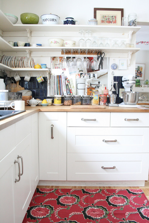 white kitchen with messy counter