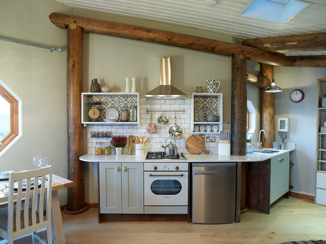 Kitchen - small rustic single-wall medium tone wood floor kitchen idea in Other with an undermount sink, shaker cabinets, gray cabinets, white backsplash, subway tile backsplash, white appliances and no island