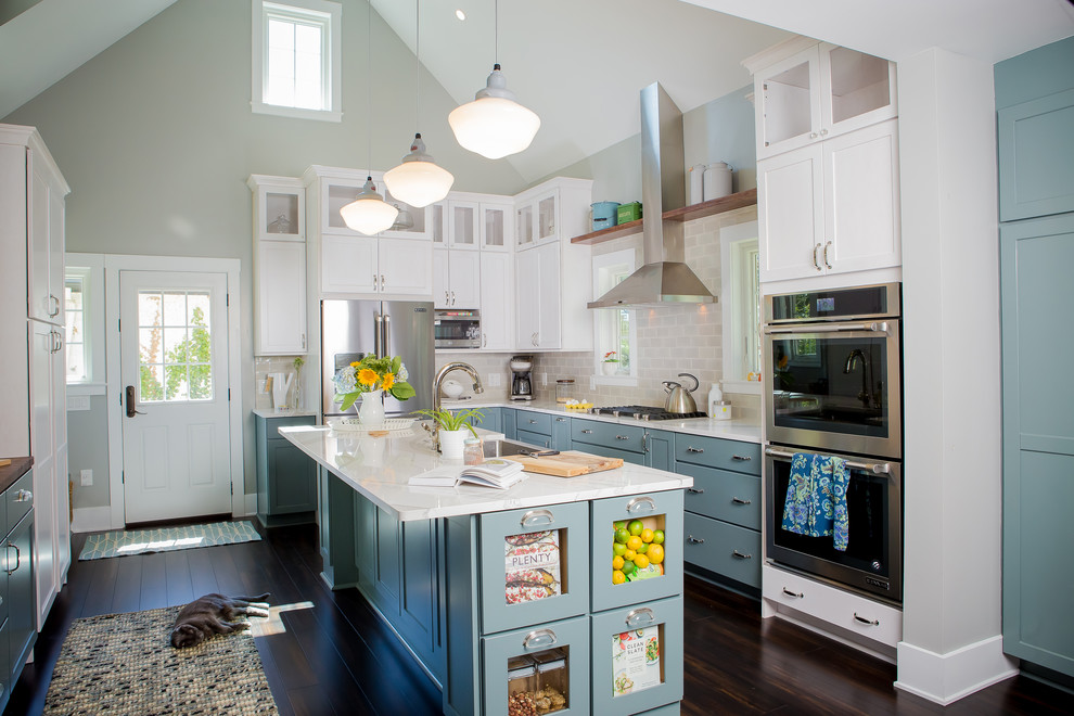 Kitchen - large traditional u-shaped brown floor and bamboo floor kitchen idea in Other with shaker cabinets, white cabinets, subway tile backsplash, stainless steel appliances, an island, a farmhouse sink, quartzite countertops and gray backsplash